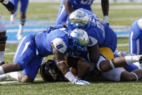 Linebackers Trey Wafford and Cavellis Luckett combine for a tackle against Southern Miss.  Photo by Greg French MTSU Sidelines Staff Photographer