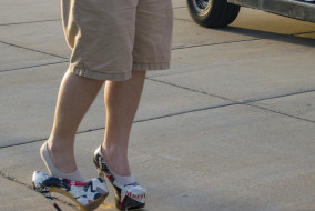 MTSU freshman Matthew Starnes dons high heels durring Walk a Mile in Her Shoes anti violence walk on April 1, 2015. (MTSU Sidelines/ Sarah Taylor)
