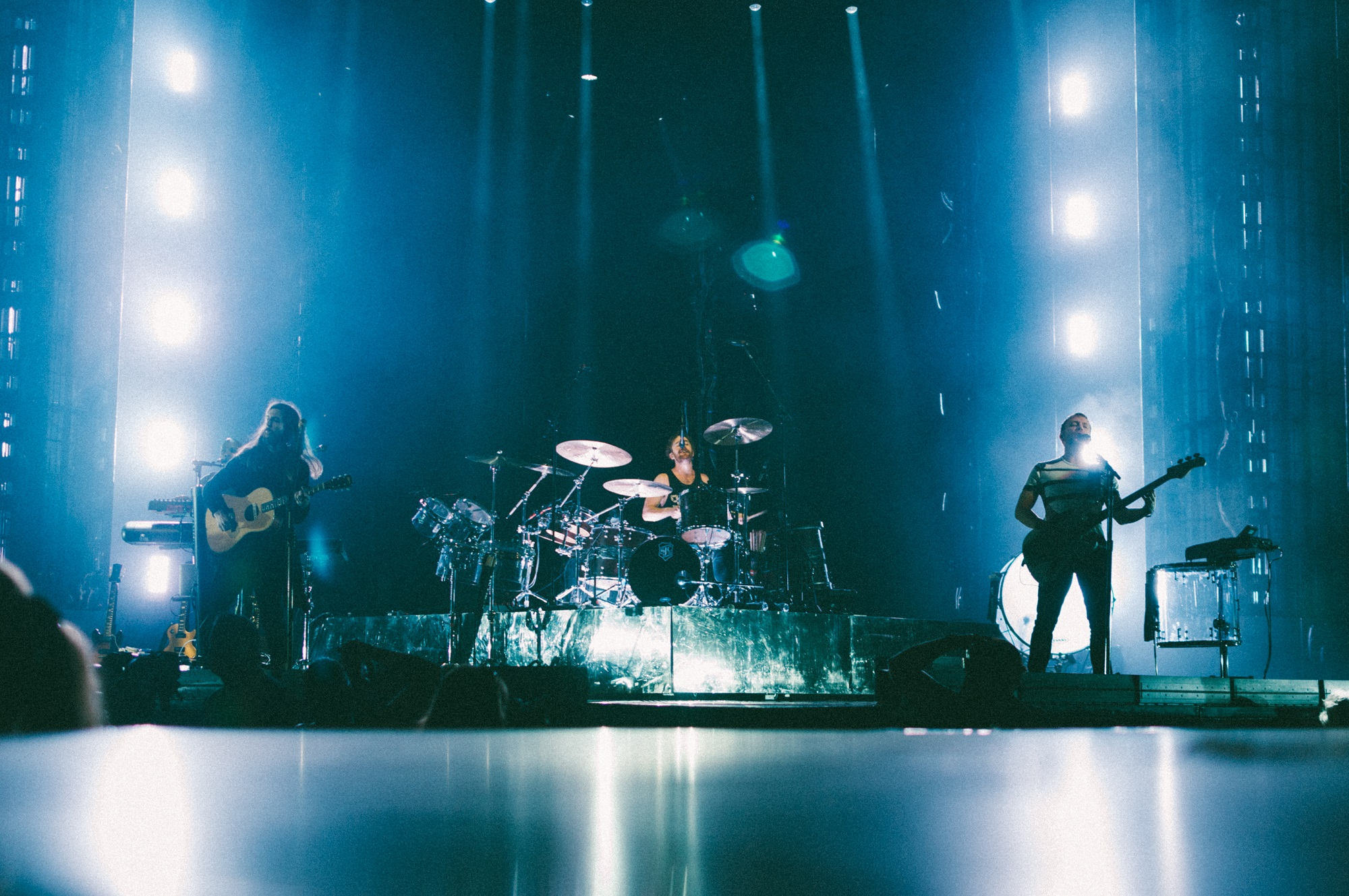 "Wayne Sermon, left, Daniel Platzman, center, and Ben McKee, right, of Imagine Dragons perform at Bridgestone Arena in Nashville, Tenn. on Wednesday, June 8, 2015, The performance was part of the band's ""Smoke + Mirrors"" tour. (MTSU Sidelines / Andre Rowlett)"
