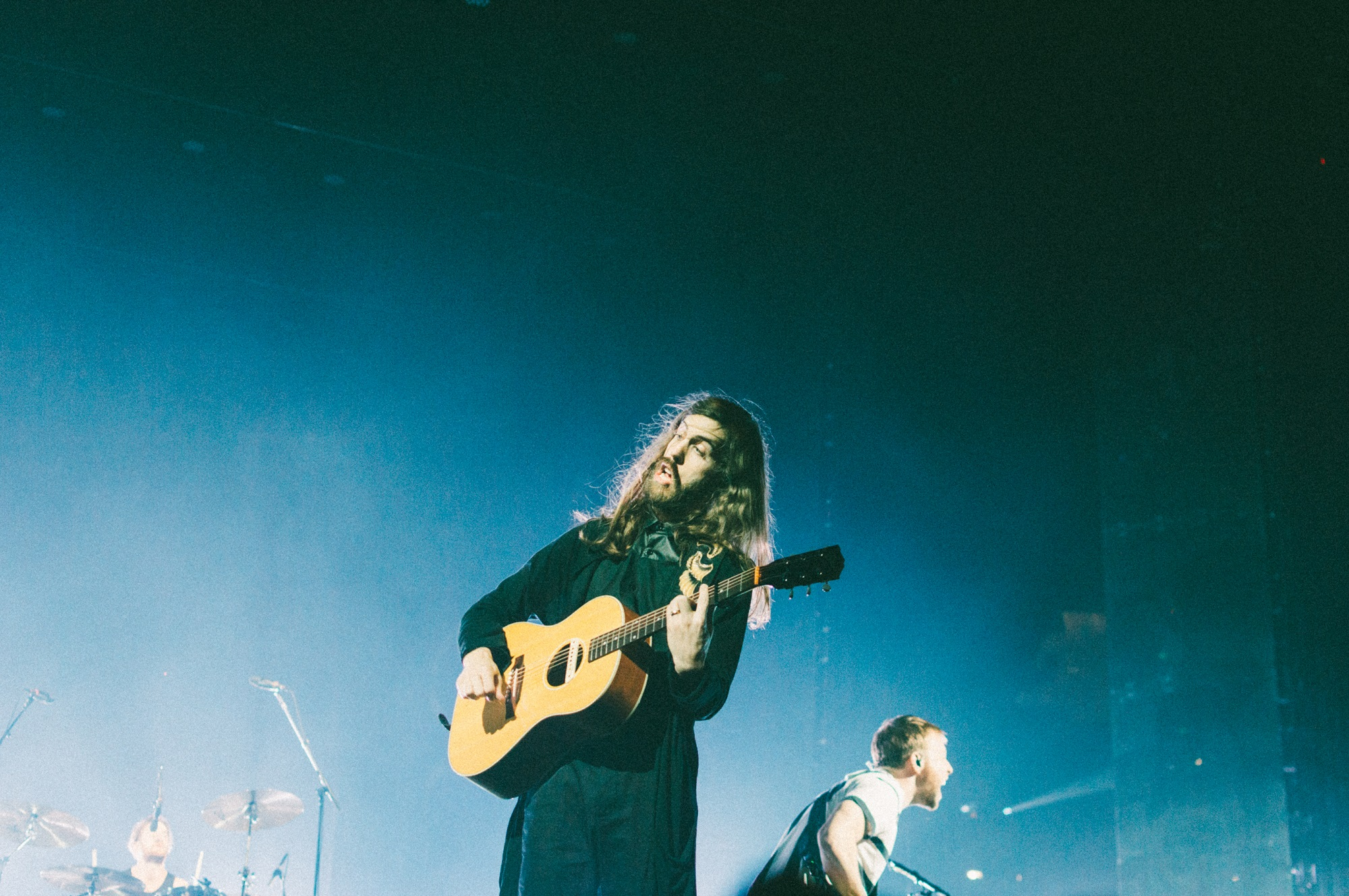 """Wayne Sermon of Imagine Dragons performs at Bridgestone Arena in Nashville, Tenn. on Wednesday, June 8, 2015, The performance was part of the band's """"Smoke + Mirrors"""" tour. (MTSU Sidelines / Andre Rowlett)"""