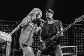 "Emily Haines, left, and Joshua Winstead, right, of Metric perform at Bridgestone Arena in Nashville, Tenn. on Wednesday, June 8, 2015, The performance was part of Imagine Dragons' ""Smoke + Mirrors"" tour. (MTSU Sidelines / Andre Rowlett)"