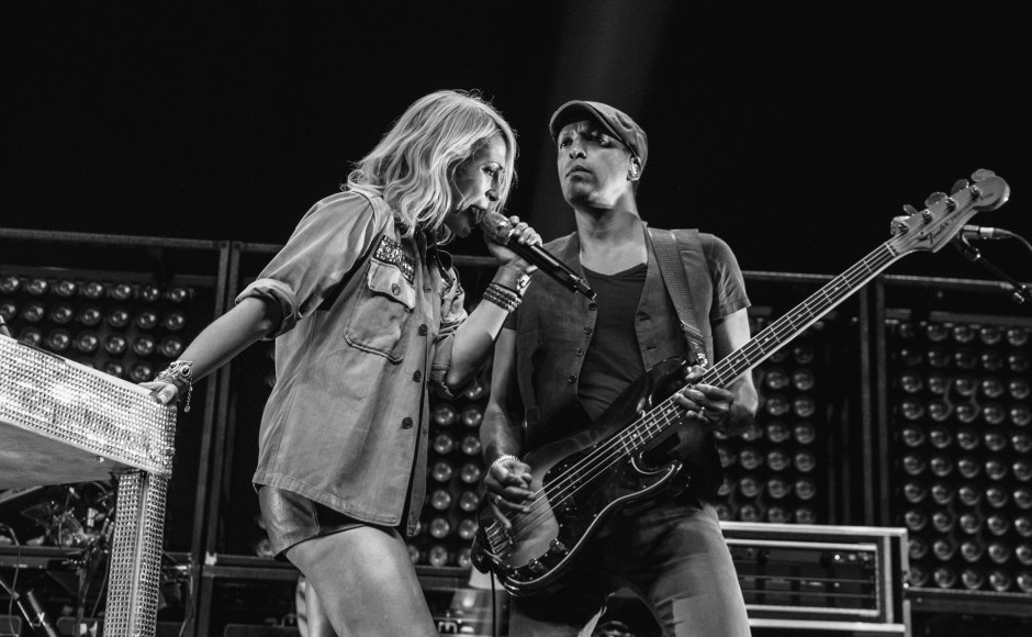 """Emily Haines, left, and Joshua Winstead, right, of Metric perform at Bridgestone Arena in Nashville, Tenn. on Wednesday, June 8, 2015, The performance was part of Imagine Dragons' """"Smoke + Mirrors"""" tour. (MTSU Sidelines / Andre Rowlett)"""