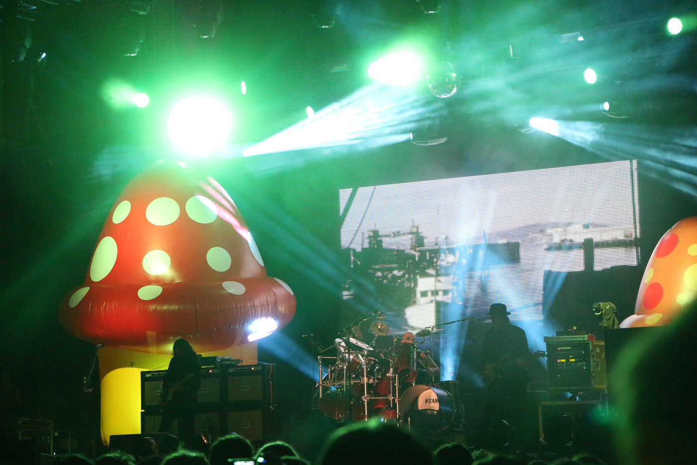 Larry LaLonde, left, Tim Alexander, center, and Les Claypool, right, of Primus perform at the Sloss Music & Arts Festival in Birmingham, Ala., on Sunday, July 19, 2015. (MTSU Sidelines / John Connor Coulston)