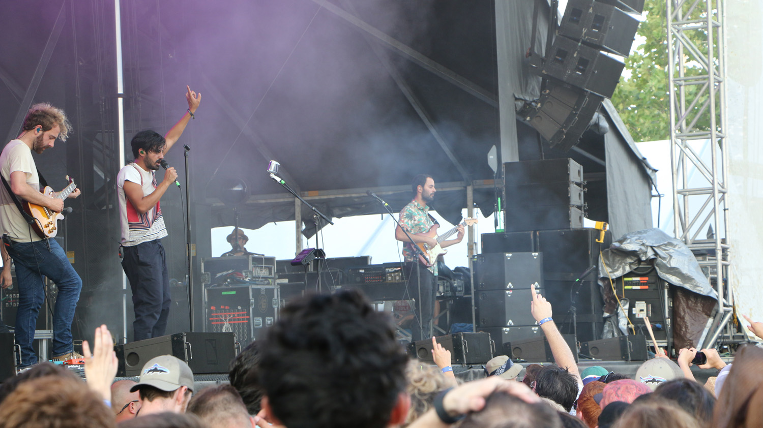 Jacob Tilley, left, Sameer Gadhia, center, and Eric Cannata, right, of Young the Giant perform at the Sloss Music & Arts Festival in Birmingham, Ala., on Saturday, July 18, 2015. (MTSU Sidelines / John Connor Coulston)