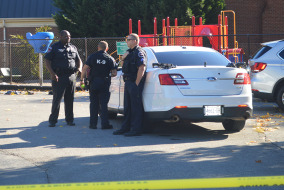 Police officers in the parking lot of the Pre-Kindergarten at Oaklands Court after a shooting nearby.  Photo by Sarah Taylor Staff Writer MTSU Sidelines