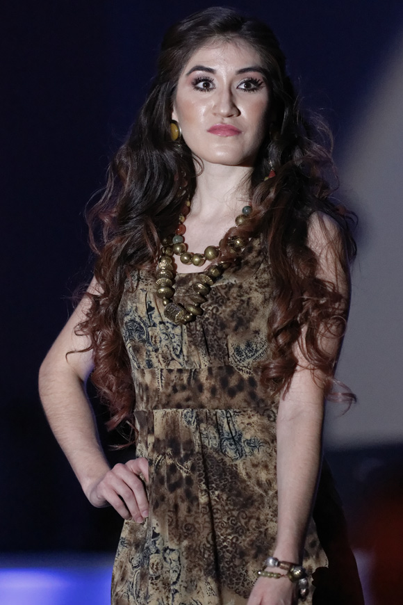 """Araceli Garcia models during the """"Dressed to Give Fashion Affair"""" at Stones River Country Club in Murfreesboro, Tenn. on Saturday, Nov. 22, 2014. The event was a fundraiser for Helping Hands Worldwide Services. (MTSU Sidelines/Greg French)"""