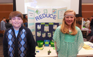 Fifth-graders Jackson McCrae and Hope McDonald stand at MTSU's 23rd annual Invention Convention in the Student Union Ballroom February 26, 2015, with a game they invented to teach good recycling habits. Photo by Christa Adams