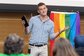 Alan Gendreau, former MTSU football player, speaks on the opening day of the inaugural LGBT+ College Conference in the Student Union ballroom. / Photo courtesy of News and Public Affairs.
