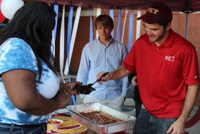 EJ Graves and Kyle Elliott of Phi Kappa Tau serving chili at the MTSU Homecoming Chili Cook-Off   Photo courtesy of MTSU Fraternity and Sorority Life