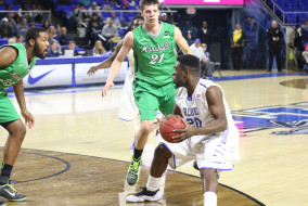 Freshman guard Giddy Potts receives a pass during the match against Marshall. Coach Kermit Davis and the Blue Raiders trample the Thundering Heard in a 90-51 victory on the night of Thursday February, 19th. (MTSU Sidelines/R.J. Estrella)