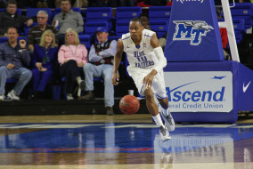Junior forward Jaqawn Raymond dribbles down court during the game against Marshall. Coach Kermit Davis and the Blue Raiders trample the Thundering Heard in a 90-51 victory on the night of Thursday February, 19th. (MTSU Sidelines/R.J. Estrella)