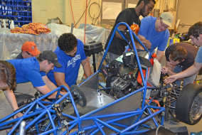 It's all hands on deck for the MTSU Formula Hybrid team. Before leaving for Loudon, New Hampshire, for the April 27-30 competition, they made numerous adjustments to their vehicle. (MTSU photo by Randy Weiler)