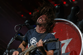 Dave Grohl of the Foo Fighters performs at Bridgestone Arena in Nashville, Tenn., on Monday, Oct. 5, 2015. (MTSU Sidelines/Gregory French)