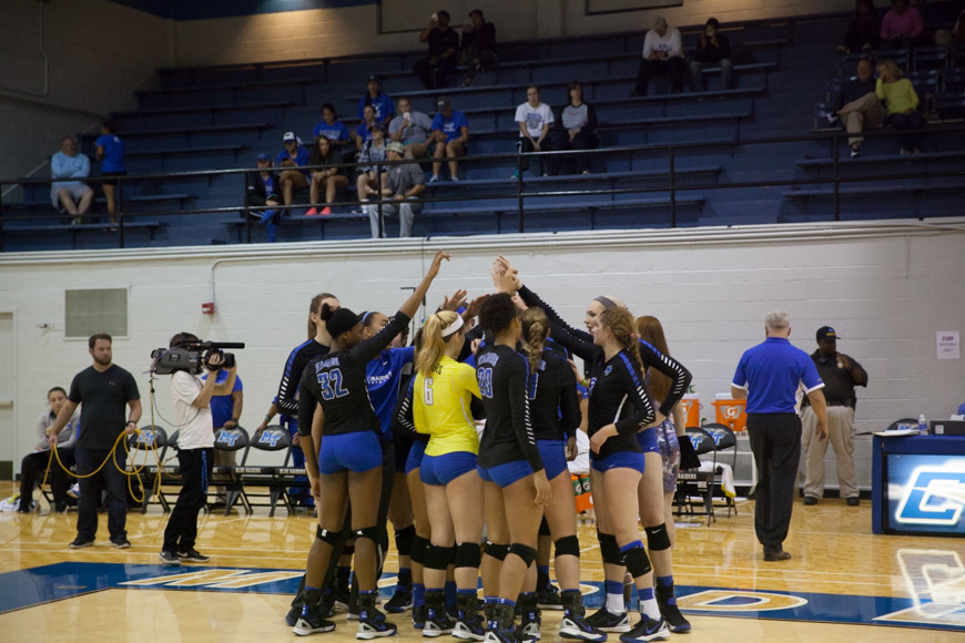 MTSU's women's volleyball team puts all hands in after a timeout huddle, October 4th 2015. MTSU's women's volleyball team faced Western Kentucky University Sunday.