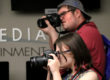 Cody and Allison shoot photos in the Center for Innovation in Media during a photo bingo game Tuesday, July 12, 2016.