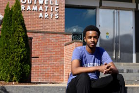 Elvis Karegeya sits outside the Boutwell Dramatic Arts building on MTSU's campus in Murfreesboro, Tenn. on Tuesday, October 18, 2016. (MTSU Sidelines/ Olivia Ladd)
