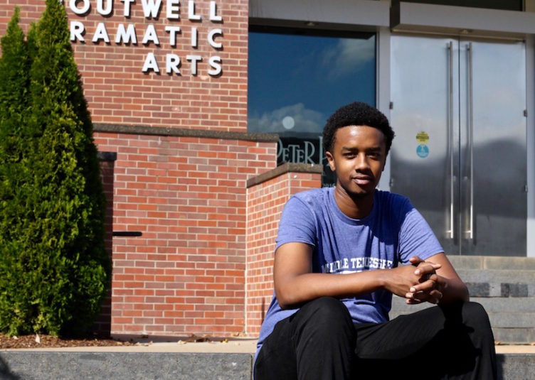 Elvis Karegeya sits outside the Boutwell Dramatic Arts building on MTSU's campus in Murfreesboro, Tenn. on Tuesday, October 18, 2016. (MTSU Sidelines/ Olivia Ladd)