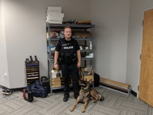 Officer Zach Brooker stands with his K9, Bobby.(Angele Latham/ MTSU Sidelines)
