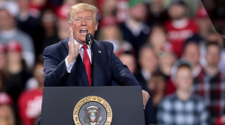 Trump speaks to a rally in Michigan before he gets news of his impeachment